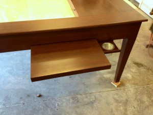 Pullout shelf and cupholder