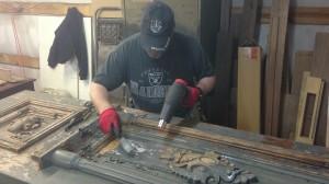 Using heat gun to remove paint.