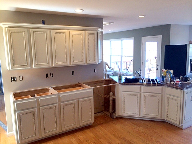 Refinished kitchen cabinets before and after for Carpenter for kitchen cabinets